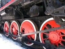 Rode wielen van oude locomotief stock foto