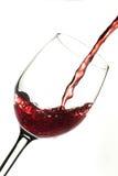 Rode wijn in glas stock fotografie