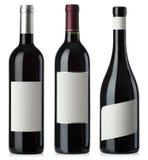 Rode wijn lege flessen met etiketten royalty-vrije stock afbeelding