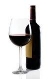 Rode wijnglas en fles Stock Foto's