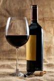 Rode wijnglas en fles Royalty-vrije Stock Afbeelding