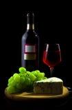 Rode wijnglas en fles Royalty-vrije Stock Foto's