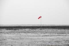 Rode windsock in desaturated prairie royalty-vrije stock fotografie
