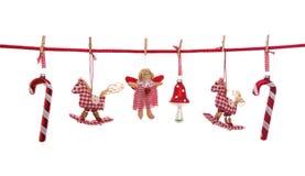 Rode witte gecontroleerde die Kerstmisdecoratie bij het witte hangen wordt geïsoleerd Royalty-vrije Stock Afbeeldingen