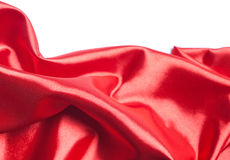Rode zijdestof over witte achtergrond Stock Foto