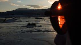 Rode zon, blauwe zonsondergang Stock Afbeeldingen