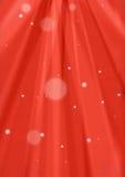 Rode zonnestraal en sneeuwachtergrond royalty-vrije stock afbeelding