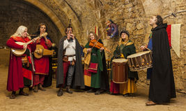 Medieval Band. Rodemack,France- December 09, 2012:Medieval band playing indoor in a rocks cave during a historical reenactment festival in Rodemack, France Stock Photography