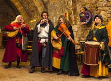 Medieval Band. Rodemack,France- December 09, 2012:Medieval quartet playing indoor in a rocks cave during a historical reenactment festival in Rodemack, France Stock Photos