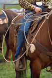 Rodeo. Detail close up of Western Horse Saddle and Lasso rope, and Rodeo Cowboy in the saddle Royalty Free Stock Photography