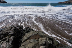 Rodeo Beach California rocks waves and sand Stock Photos