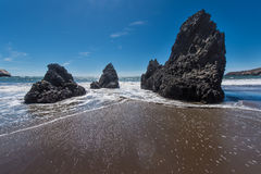 Rodeo Beach California rocks waves and sand Stock Photo
