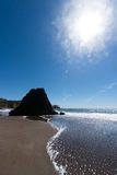 Rodeo Beach California rocks waves and sand Royalty Free Stock Images