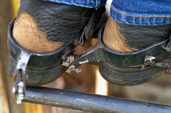 Rodeo Boots and Spurs. Detail close up of  Rodeo Cowboy's leather boot and spurs, standing on fence railing Stock Images