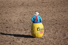 Rodeo clown in a barrel watching bull Royalty Free Stock Image