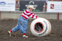 Rodeo clown pushes barrel. Royalty Free Stock Image