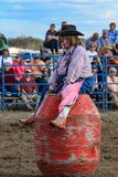2018 Rodeo Clown. Rodeo Clown sitting on barrel during the event royalty free stock image