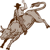 Rodeo cowboy bull riding Royalty Free Stock Photography