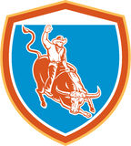 Rodeo-Cowboy Bull Riding Shield Retro- Stockfotografie