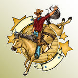 Rodeo Cowboy riding a horse Stock Photography