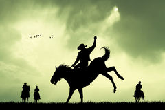 Rodeo cowboy silhouette at sunset Stock Image