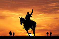 Rodeo cowboy silhouette at sunset Stock Photos