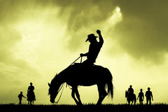 Rodeo cowboy slhouette at sunset Stock Photos