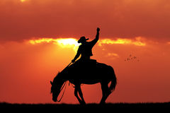 Rodeo cowboy at sunset. Illustration of rodeo cowboy silhouette at sunset Stock Photography