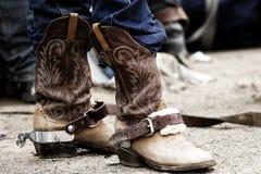 Rodeo-Cowboystiefel u. Sporne Stockbild