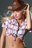 Rodeo cowgirl in cowboy hat Stock Photography