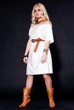 Rodeo cowgirl in white dress Royalty Free Stock Photography