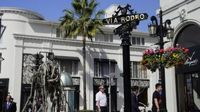 Rodeo Drive in Beverly Hills. Tourist enjoy at the entrance of Via Rodeo in Beverly Hills