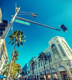 Rodeo Drive sign under a clear sky Stock Photos