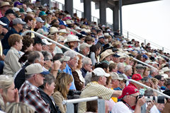 Rodeo fans. APACHE JUNCTION, AZ - FEBRUARY 26: Rodeo fans watch the action at the Lost Dutchman Days rodeo on February 26, 2010 in Apache Junction, Arizona royalty free stock photos