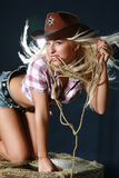 Rodeo girl in sheriff hat Stock Photo