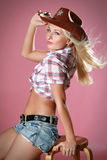 Rodeo girl wearing a cowboy hat Royalty Free Stock Image