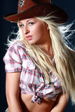 Rodeo girl wearing a cowboy hat Stock Photo
