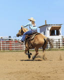 Rodeo Girl. Woman riding horse in barrel competition at the rodeo Royalty Free Stock Photography