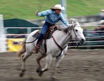 Rodeo: Ladies Barrel Racing Stock Photo