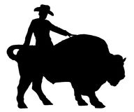 Rodeo man on a buffalo, bison, bull, silhouette. Royalty Free Stock Images