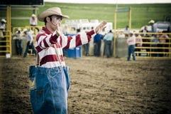 Rodeoclown und -cowboys Stockbild