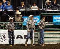 Rodeocowboyer och domare Royaltyfri Bild