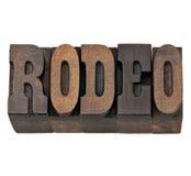 Rodeowort in der Weinlesebriefbeschwerer-Holzart Lizenzfreie Stockfotos