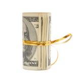 Rodillo de los dólares envueltos en raya del oro Fotografía de archivo