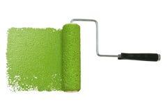 Rodillo de pintura con verde Imágenes de archivo libres de regalías