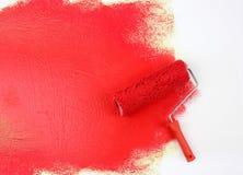 Rodillo de pintura rojo Foto de archivo libre de regalías