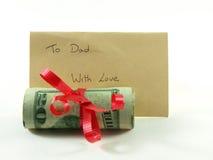 Rodillo del dinero para el papá Imágenes de archivo libres de regalías