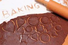 Rodillo en la pasta para las galletas y la hornada de la palabra Imágenes de archivo libres de regalías