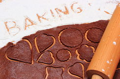Rodillo en la pasta para las galletas y la hornada de la palabra Fotos de archivo libres de regalías