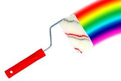 Rodillo y arco iris de pintura Fotos de archivo libres de regalías